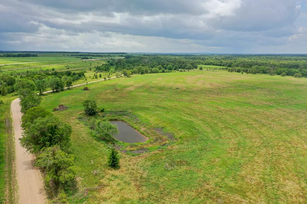 Come and check out this beautiful piece of property.  Farmland/Hay Production.  Great county road frontage, perfect multiple use property for agricultural use or your future homesite. New Solar water well. Seller is not retaining minerals if any. Seller to retain first cut of Hay.  Approximately 30 minutes from Taylor, 50 minutes from Round Rock and 60 minutes from Austin. A great getaway.