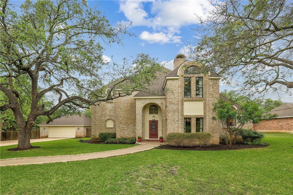 Stately home with sweeping archways and soaring ceilings. This stunning 4 BD/ 2.5 BA home sits on a huge tree-lined, 1-acre lot. Stunning mature oak shade trees out front. The long front drive leads to the oversized two-car detached garage. The winding pathway leads to the arching front entryway. The elegant living room features high beamed ceilings, high-end laminate wood flooring, crown molding, and a wet wine bar with room for a wine fridge. The home chef will be delighted with the gourmet kitchen featuring elegant custom white cabinetry, granite countertops, deep vaulted ceilings, a breakfast dining area, a built-in oven, and a cooktop on the kitchen island. The Owner's Suite is secluded away on the main floor and features a huge luxurious ensuite bath with a large jacuzzi garden soaking tub, walk-in tile rain shower, and access to the back deck. Huge bonus media room on the second floor with 3 spacious bedrooms and a Jack-n-Jill bathroom with two commodes. Relax on the covered patio and enjoy the spectacular central Texas sunsets. Enormous private tree-lined fenced yard with room for you to create your ultimate backyard oasis. Room for a pool & a guesthouse. Private water well & septic. Zoned for Leander ISD. Located near Dell Diamond, Old Settler's Park, Kalahari Resort, excellent restaurants, tons of shopping, and more! Easy access to major highways.