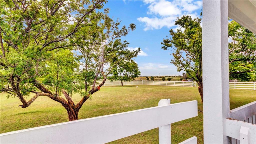 Glorious panoramic sunsets and sunrises, sipping tea on your choice of 2 porches as gentle breezes and fireflies dance on the horizon at this perfect country setting, Wake up to fresh air and birds singing, Texas Longhorns in the distance, a slower pace of life, yet still only 15 mins from Historic Georgetown and Taylor, 40 Mins from the new Tesla plant, 45 mins from downtown Austin. Centrally located for an easy drive to Dallas, Houston, and San Antonio. All the comforts of country living with All the Conveniences of City life close by giving you the best of both worlds. This property has it all, a Spacious Open Floor plan, barn, pond. It includes a 35.5 by 28 ft Barndominimum Framing Kit and plans for a darling 2 bedroom 1 bath casita.  Two plum trees in harvest right now, 2 peach trees, 2 pecan trees, 1 fig & 1 pear tree.  Garden area w/an asparagus bed. Kicking it ole school outdoor clothesline, nothing better than crawling into bed with those fresh sheets. This is just a taste of what this home has to offer. Come see for yourself.