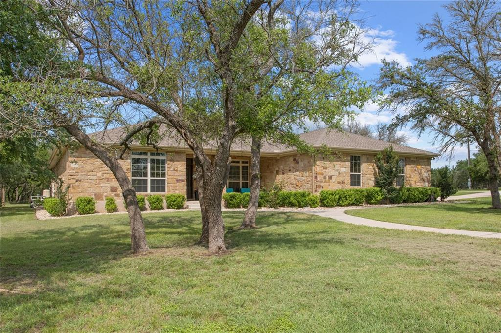 This custom home on 4.4 acres, with beautiful trees, in the highly desired gated Sundance Ranch subd has it ALL...including heated tile floors in the master bath!  Awwww!!!  There are custom features throughout this 1 story home with 3 bedrooms, formal dining, breakfast area and flex/craft/home office room (or 4th BR).  Windows across the back of the house look out onto the beautiful, inground pool with waterfall and backyard oasis with a covered patio and detailed landscaping! Custom kitchen boasts granite countertops, subway tile backsplash, induction cooktop, center island, knotty alder cabinets, double oven.  Kitchen is open to the breakfast area (with extra cabinetry), living room (custom stone fireplace) and formal dining area (double trayed ceiling).  The spacious primary bedroom with it's spa like bathroom is a gem!   Chromatherapy jetted tub (soothing colored lights), two walk in closets, two vanities, awesome walk in shower!  The two secondary bedrooms include window seats and custom cabinets.  They have their own closets and sinks and share shower and toilet (jack and jill set up).  No detail was excluded..the utility room has a sink, folding table, built in ironing board and plenty of storage!  Entire house also wired for audio system. Also includes 30x40 shop with 40x15 RV cover for extra storage, boat storage, ranch use...whatever is needed!  Located in highly sought after Liberty Hill ISD and can be accessed two different ways....Sundance Ranch entrance off of CR 220 or back gate off of CR 214.