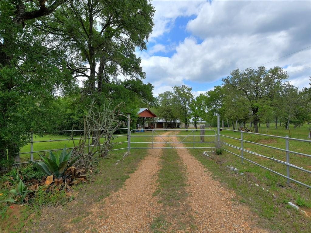 MORELAND RANCH.  92.893 Acres! A true Texas classic!  Live water along beautiful Walnut Creek frontage with so much wildlife!   Home to whitetail deer, migratory birds of all kinds including hummingbirds, cardinals, purple martins, and so much more!  White limestone original ranch house with studio and large deck in the back.  2 car garage and carport for equipment.  Very private at the end of the road.  Great soil for organic gardening!  Large trees throughout.  Hay pasture and gorgeous stock pond full of fish.  Conveniently located within an hour of Austin, ABIA, COTA, SH 130 Toll, Hyatt Regency Lost Pines Resort & Spa, and the new Tesla plant. Two hours from Houston and San Antonio.
