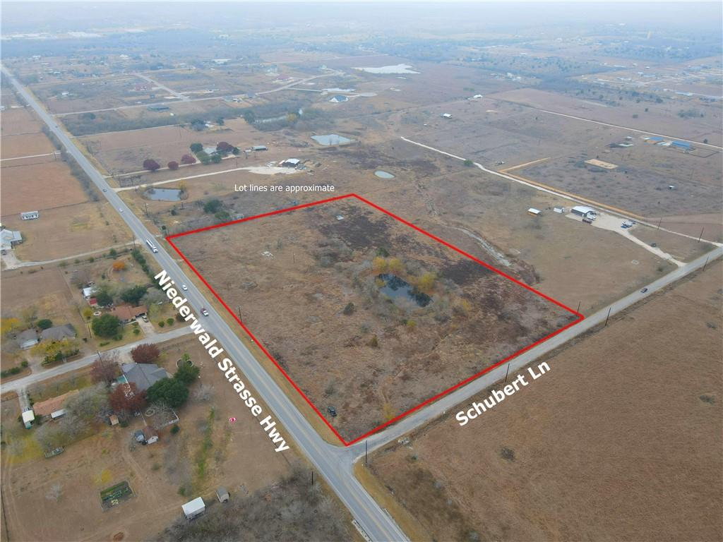 Perfect hard corner, 8.9 acre commercial lot, located on Niederwald Strasse Hwy & Schubert Ln with an abundance of road frontage & vehicle traffic. This area is growing exponentially with residential communities, but lacking commercial sites. This would be a great spot to fill that void. Already zoned commercial with city of Niederwald. Water & Electric available at the road, septic needed. Approximately 5+/- acres is in the floodplain.