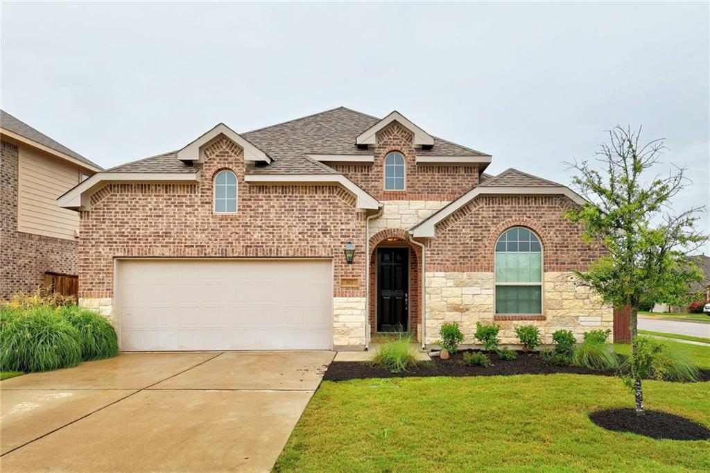 Stunning one-story home in coveted Parkside at Mayfield Ranch that feels like new! This home truly has it all; an inviting open floor plan, plus plenty of private space for everyone. The living spaces and office offer real hardwood floors. The floor-to-ceiling masonry fireplace in the living room highlights the tall ceilings. In the kitchen there are beautiful, low-maintenance silestone countertops and a subway tile backsplash along with stainless steel appliances, a gas range, and a Texas sized pantry. An upgraded extended vanity mirror in master bathroom along with a step-down enlarged shower make the master bath a luxurious spa-like experience. The office offers serenity via its french doors. The mother-in-law plan has a private bathroom for guests or teens. Enjoy the custom designer window treatments throughout the home with blackout blinds in the master bedroom and one other.  Relax on the covered back patio, walk to the pool and Parkside Elementary school (