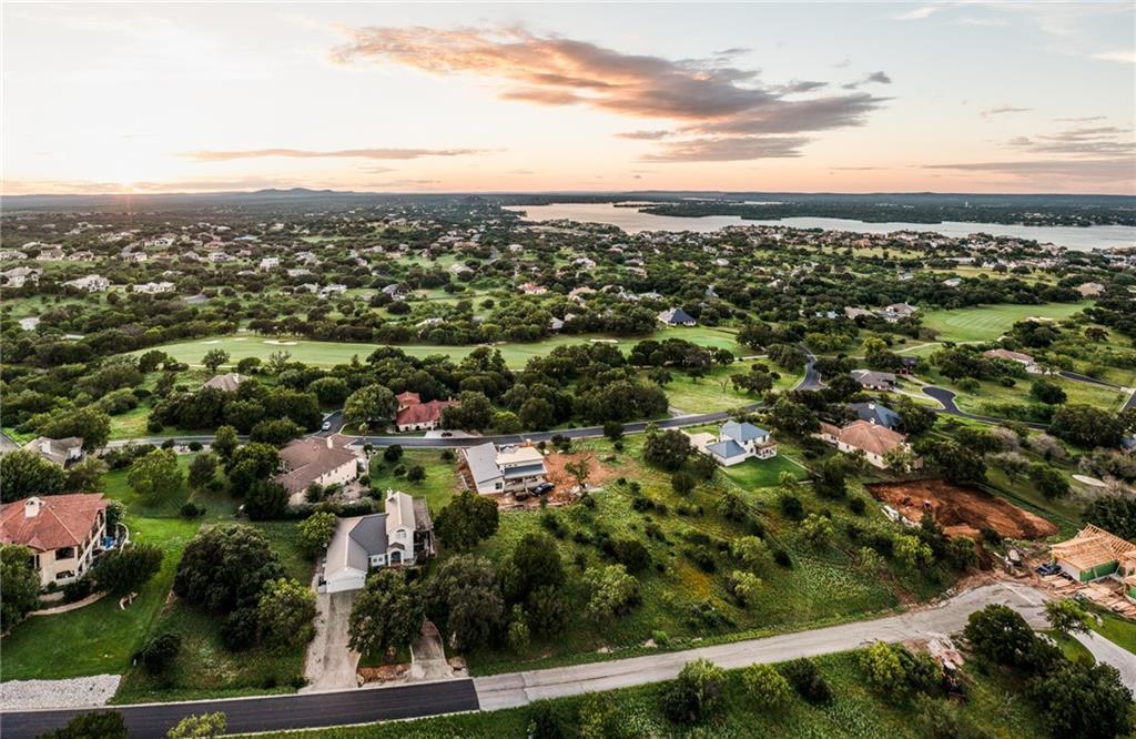 Another stunning home by Peterson Construction! Welcome to 1903 Fault Line, in the heart of Horseshoe Bay Texas! This modern custom home is currently under construction and is set to be completed in September 2021. Sitting on an oversized lot, this home boasts panoramic views of Lake LBJ and the gorgeous Texas hill country. Off of the entryway, you'll enter into a large great room with a high ceiling, ranging from 10' to 14'. The kitchen will feature high-end stainless steel appliances, waterfall granite countertops, and custom wood cabinets. Off of the kitchen, you will find a large butler's pantry that will offer additional storage and stainless steel appliances. The high ceilings continue into the dining area, where you will also find several large windows bringing in a tremendous amount of natural light. This home features three large bedrooms, three full bathrooms, walk-in closets, and a split - single level floor plan. In addition to the great room, the primary suite has 10'-14' ceilings throughout and a grand en-suite bathroom. The primary bathroom will hold custom wood cabinets, dual sinks, toilet closet, granite countertops, walk-in shower, soaker tub, and a large walk-in closet that leads into the laundry room. One feature of this fantastic home is the large custom, glass slider that leads to the outdoor living area. In addition to the covered back porch, there will be a custom fireplace and kitchenette built in - ideal for outdoor entertaining! This home is a SHOW STOPPER! Don't miss out!