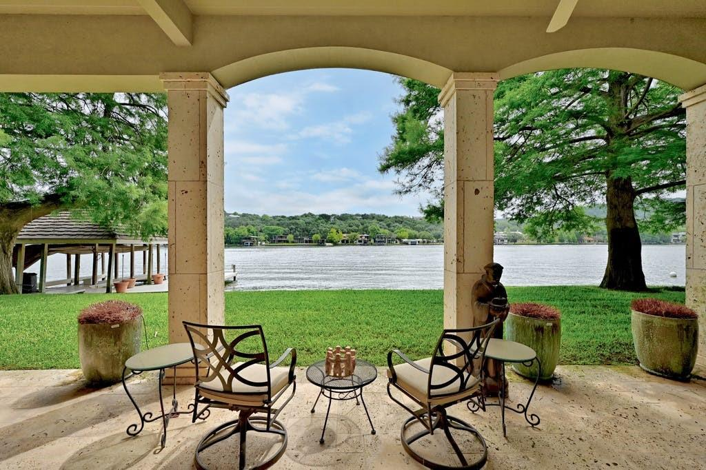 """Rare Lake Austin opportunity in Eanes ISD and first time offered for sale! This property is beautifully sited on the banks of Lake Austin to maximize the views of the water from every area within the house--in fact, the views connect you with the 167ft of Lake Austin water frontage from the entire width of the house!  This private, gated section of Rockcliff Road is an area often referred to as """"The Gold Coast of Lake Austin"""" because of the location on the lake, the flat lots with lapping waterfront, Eanes ISD schools, proximity to downtown with convenient access to Loop 360 and Mopac/Loop1, and the east/northeast orientation.  Designed by Cornerstone Architects and custom built by Brian Bailey Homes in 1995, this 4BD, 4Full+2Half Baths, 4Living property has been loved and enjoyed by the same family since that time.  Designed for entertaining, this open floor plan design and inviting feel was forward thinking and serves a casual and practical lifestyle very well.  Of course, the waterfront and ready-access to the lake is enhanced and made easily available by the generously sized 2 stall covered boat dock and swim deck. Not ready for a boat ride or a swim? Then enjoy the fun and exciting and at the same time peaceful and soothing, water views from the generous terrace across the back of the house. This .66 Acre lot is sprinkled with beautiful trees, including several majestic cypress trees that thrive near the waterfront! Lake Austin is truly one of Austin's finest treasures, and this lovely home will no doubt provide many years of pleasure for the next lucky owner."""