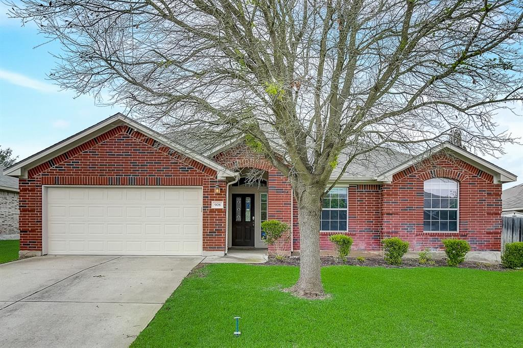 This Pflugerville one-story cul-de-sac home offers a two-car garage.