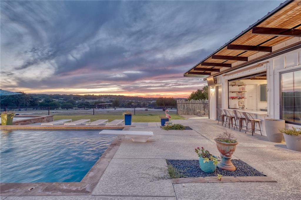 """This amazing compound is uniqueness at its finest. The property encompasses a total of 6 tiny homes, not to mention a gorgeous pool house, in-ground pool, basketball court, volleyball court, bocce ball court, custom swing area, and so much more! As soon as you enter through the large gated entry, the property screams FUN. The """"Main House"""" is a 4BD/2BA and 1458 square feet, """"Hope's House"""" is 2BD/1BA and 900 square feet, """"Cedarville"""" is 2BD/2BA and 680 square feet, """"White House"""" is 1BD/1BA and 608 square feet, """"Bungalow"""" is 1BD/1BA and 315 square feet, the Pool House is 782 square feet with a large living area and full bath, and lastly, there is an adorable 260 sq ft office at the top of the property. From exotic animals to pool games and a fun hike through the gorgeous 10 acres, the opportunities on this property are about as big as they come. Ag exemption is near completion and all exotic animals convey! Buyer's responsibility to perform due diligence and verify deed restrictions."""