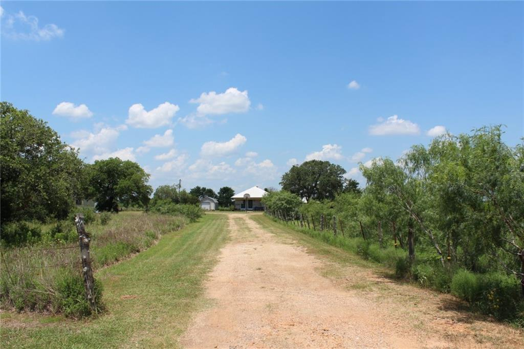 60 Acres + older Farmhouse with outbuildings & improvements located just south of Cistern, TX.  Two ponds, fenced, Ag exemption in place.  Includes 58.13 acre + 1.32 acre parcels.  Farmhouse is owner-occupied and features 2 bedrooms, 1 handicapped accessible (updated) bathroom, large pantry, large walk-in closet, formal dining room, newer metal roof, central HVAC installed last year and covered front porch; house still needs cosmetic updates and some repairs; sold as-is.  House is on septic system, Fayette Water & Fayette Electric. There is also a water well but it is not hooked up. The land has a narrow creek running through the back of property; creek bed is in floodplain, all other land area not in floodplain.  Perimeter fence in fair condition.  Current livestock lease on property. Highway frontage. Old mobile home on property used for storage only, also has large metal shed for storage or workshop, 2 car garage with w/d hookups, older wooden structures: chicken coop, barn, smokehouse.  A real country farm that has been passed through the Thiede family for decades being sold by descendants due to health issues.
