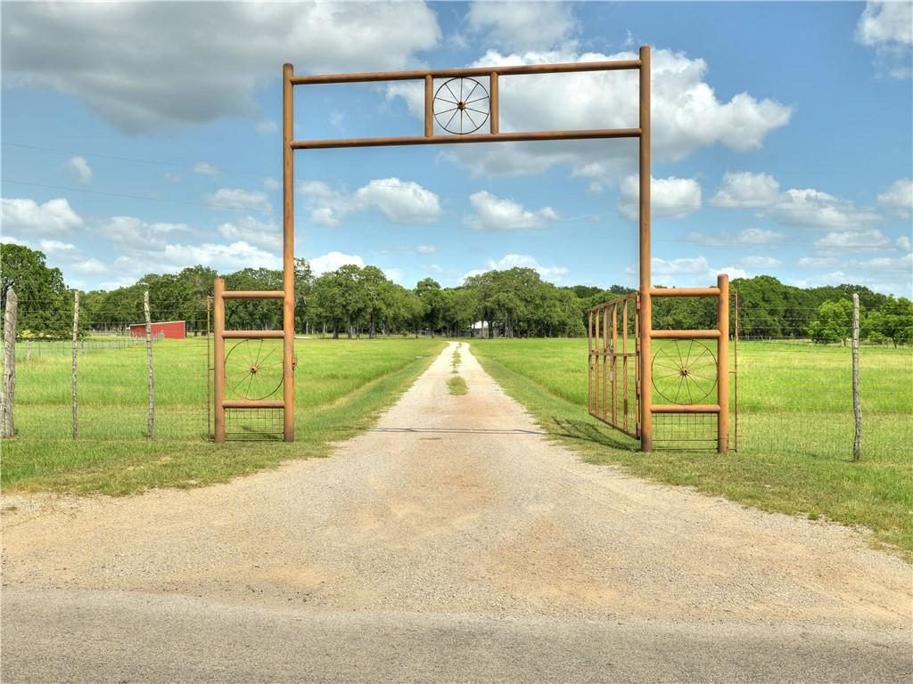 Amazing opportunity to own a piece of the Texas Hill Country.  35+ acres with panoramic views, gentle breezes & large oaks await your hammock!  Main residence has 3 bdrms and 2 baths.  Barndominium is 1200 sq foot 1 bdrm- 1 bath.  Property is fully fenced and cross-fenced for livestock.  Coastal hay and two tanks/ponds, one of which can be supplemented by it's own well.  Paddocks and corrals, two barns, 2 septics, 2 wells and a granite road are just a few of the amenities on this Gentleman's Ranch.  Great potential for rental income from the barndomium or a fantastic multi-generational set-up.  This property fronts a paved county road.  City water is available at the road.  Minutes to HEB, hospital, restaurants and the Highland Lakes!
