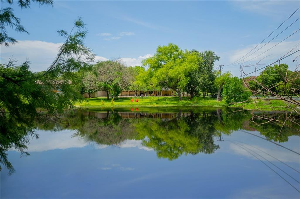 """This gem of a home is located in the beautiful tranquil subdivision of Tonkawa Springs. The pride of ownership can really be felt in this  4 bedroom (could be study) and 2.5 bath home. Enjoy your mornings and your evenings looking over the lush backyard and across the park-like backdrop with a pond that begs to be fished. The long stately front porch and beautiful wood door welcomes you as you enter. You can continue to enjoy the view of the back yard while in the family room, through the two sets of full lite french doors. The kitchen has been remodeled with """"slow close"""" drawers and cabinets, granite counter tops, a Bosch range, and glass front lit cabinets. You feel like you are in the country but have the conveniences of the city. With the easy access to I-35, Saint Davids hospital, shopping, eateries, and highly acclaimed schools, this home checks all of the boxes. Don't miss this one! Recent roof. According to SFHDF Structure is NOT in flood plain."""
