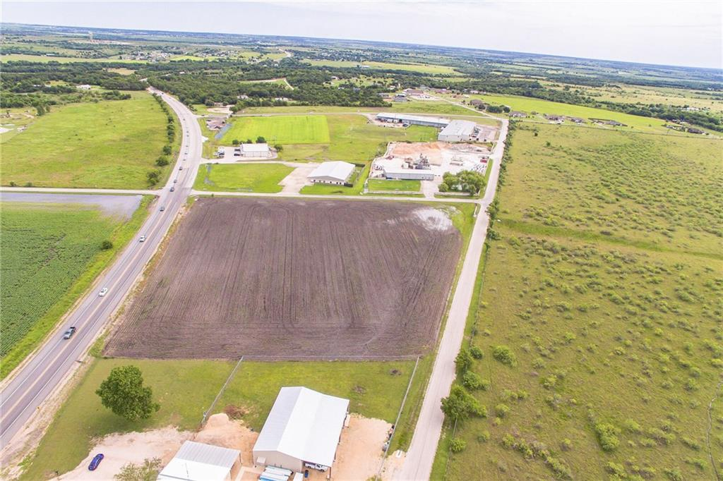 This is a 6.122 acre property currently under Ag exemption but is prime location for office buildings, retail, convenient store. Possibilities are endless. Water line runs along Old Spanish Trail and development all around the property.