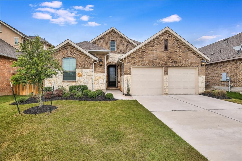 Gorgeous home in the lovely Parkside at Mayfield Ranch. This meticulously maintained 4 bedroom, 3 full bathroom home has only had one owner to date. Fantastic open floor plan with LED recessed lighting. The bright, white modern kitchen includes high-end touches including subway tile backsplash, granite countertops, gas cooktop, pantry, and stainless appliances. The remote worker will love the home office which also means you don't have to turn one of the bedrooms into a home office! The tall ceilings in the living area complement the vaulted ceilings in bedrooms and office. Extended Owner's Suite with luxurious ensuite bathroom featuring separate vanities, walk-in closet, garden soaking tub, and a walk-in tile shower. There's also a guest suite with a full private bathroom. Relax in the shade and entertain guests on the extended covered back porch. Private fenced yard with a well-manicured lawn, perfect for yard games, a playscape, pets, and more! Post-build, this home was upgraded with the following features: 2x NEMA 14-50 outlets in the garage for charging electric vehicles; a water softener; Nest Hello Doorbell, Outdoor Camera & Thermostat; Lutron Caseta smart light switches in kitchen and living room (control remotely via Lutron App); Motion detecting auto on/off switch in utility room; programmable light switch for the front porch lights; and custom-built elegant hutch cabinets in the dining room. Gorgeous community hike & bike trails lead to Wilco Regional Park (entrance at the end of the street). Other fantastic community amenities include 2 pools, parks, a playground, an impressive sports court, tennis courts, a BBQ area, and an amenity center. Great location convenient to Cedar Park, Leander & Georgetown, minutes to major thoroughfares.