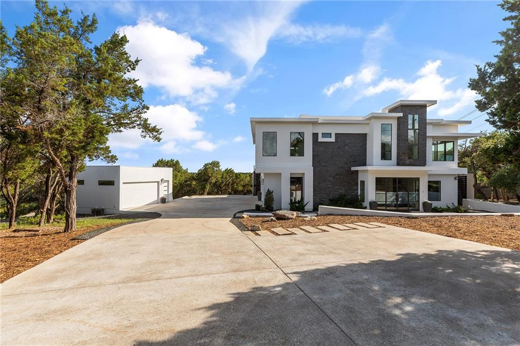 """Custom Modern Home w/Quality Finishes. One-of-a-Kind Modern designed by Architect Bennet Liu. 6 Car Garage, Private Concrete Jogging Trail, front/back sides face LCRA Protected Bird Sanctuary, View of Hill County, Lakeway, Volente, Jonestown and Lake Travis! Elegance, quality, and spaciousness describes this home. Enter double metal-framed glass doors lead you to a dramatic 2-story slate entry. White Quartz counters. All Thermador appliances and """"Meteor Shower"""" Italian chandeliers over 12' waterfall island w/farmers apron sink. Entire home has """"wood look"""" Italian Daltile Ceramic Floors. Open Living Area has 12' to 18' ceiling and 40'. long 8' high custom """"sliding glass wall"""" by Western Windows, its indoor-outdoor living at its best! Sunrise and sunset views on the large deck and directly from the Owner's Bed! Overlooking lush 715ac Baker Sanctuary! Home perched atop canyon edge for view of the Hill Country and Lake Travis! 2-story fully-insulated lighted storage """"attic"""" w/rollup door!"""