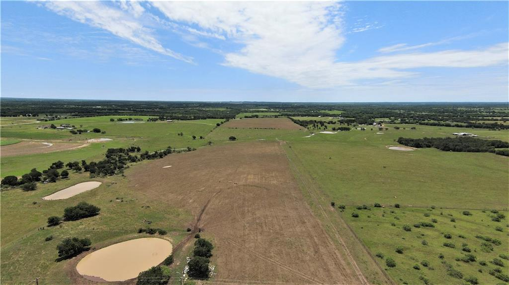 188.6 acres in with good development potential. Minimal flood plain.  Just a short drive to Elgin and in a developing area.  Currently used as a cow calf operation. 3 ponds.  The old house you see is not on this property but the driveway to the house does belong to the 188 acres and is an easement for the house. 2 adjacent tracts recently sold to investors.  Restricted to no singlewides and no manufactured homes over 3 years old.