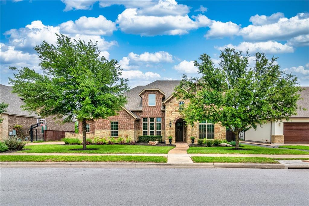 """Located in a gated community with award winning schools located on .30 acres less than 2 miles from I35, 45, and mopac and within a 25 minute drive to downtown Austin. This home has over 87K in upgrades and architectural details. Georgian wood paneled door casings, wood stairs with mosaic tile risers, crown moldings throughout downstairs, massive sandstone floor to ceiling fireplace in family room, granite counter tops in kitchen and every bathroom, formal dining with wainscoting and grass cloth wall paper, whole house water filter, whole house surge protector, custom window treatments, and battery powered custom """"duo"""" honeycomb sheer/blackout shades in the primary bedroom to name in few. Wonderful open floor plan that is great for entertaining large parties with many places to sit and play both indoors and out without feeling cramped. Flexible work from home arrangement with study and additional bedroom downstairs that could be used as a second office, custom cabinetry throughout the home and four car garage big enough for a workshop. Enjoy morning coffee in the private and peaceful backyard (no neighbors behind) The space is large enough to put a pool and still enjoy the custom Rainbow playscape that is included with the sale of the home. Arbor place is a sought after community right around the corner from the grocery store, restaurants and many shops and stores."""