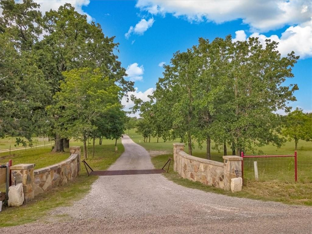 Stake your claim in Texas!  Completely fenced and cross fenced 15.321 acres with over 3000 square foot stone home plus 2017 3/2 mobile home onsite.  Large two story barn/shed. Stone entrance with cattle guard & stone mailbox.  Loads of trees; peach, pecan, walnut, apple, plum, pear & fabulous oaks!  Large covered front porch, large covered back porch with separate grilling area & pergola.  100% handicap accessible.  Breakfast nook with bay window.  Gourmet kitchen with thermador convection oven with rotisserie, stovetop & oven plus built in pot filler.  Large laundry/mud room with wet sink & built in table.  Three large sets of french doors w/transoms in living room.  Cedar ceiling beams.  Two owner suites with jack and jill master bath with soaking tub & huge walk in shower. August 2021 new roof!  Great views!  Gorgeous sunsets!  Hummingbirds by day & stars by night!