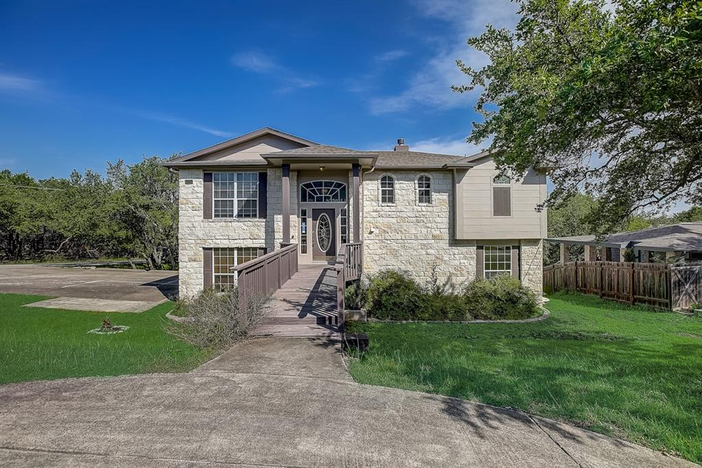 This Lago Vista two-story cul-de-sac home offers a three-car garage. This home has been virtually staged to illustrate its potential.