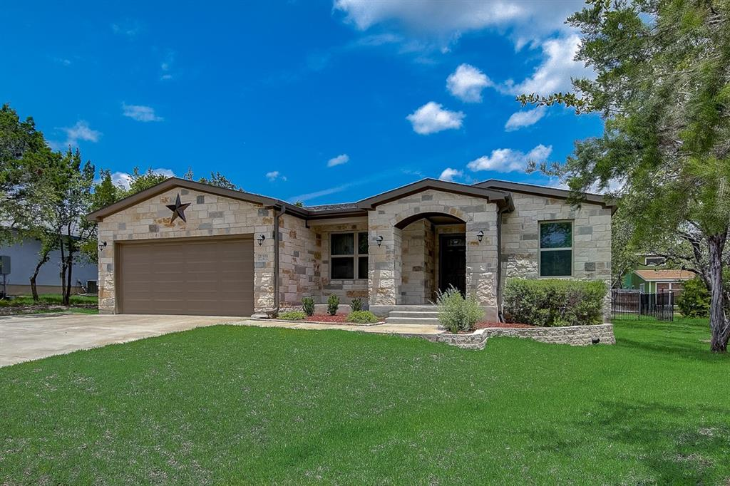 Built in 2017, this Lago Vista one-story cul-de-sac home offers granite countertops, and a three-car garage. This home has been virtually staged to illustrate its potential.