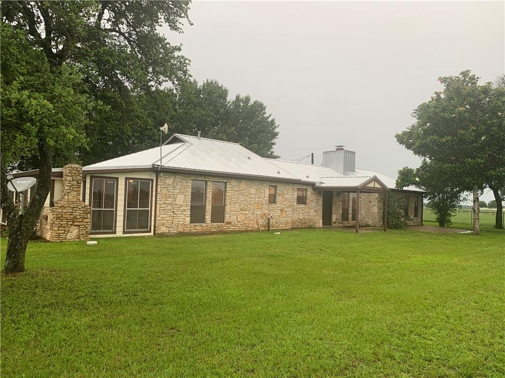 Panoramic views and a 3/3/3 remodeled house! LOW AG EXEMPT TAXES! HUGE 3 car (or truck, or boat!) garage/shop. Three bedrooms all have private baths and walk in closets. Seller has replaced the roof, septic, HVAC system and more! Huge sun porch with polished concrete floors! Built in smoker pit, real wood custom milled cabinets, propane gas heat and range, wood burning stove. Surrounded by large acreage parcels. Up to 57 acres with pond and additional barn and ranch hand house/cattle working pens also for sale!