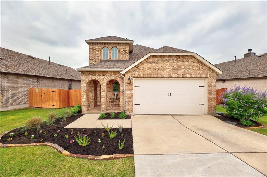 LIVE LIFE LAKESIDE in this attractive 4 bedroom/3 bath home located in Lakeside at Tessera on Lake Travis. As you enter through the custom front door, you will notice the bright and open floorpan complete with upgraded wood look tile flooring. The wall of windows offers tons of light in the spacious living room that flows into the large kitchen complete with a huge island, updated kitchen hardware, and lots of cupboards and storage. The stunning upgraded banister and railing leads you upstairs to a generous sized game room, 2 additional bedrooms, and bath where you find a peek-a-boo view of the lake. The back porch and yard are perfect for a BBQ and entertaining. Community amenities include a resident-only boat launch, waterfall edge pool with splash pad, pavilion overlooking the lake, miles of hiking/biking trails, playground and beaches. The community is approximately 25 minutes to shopping and dining in Cedar Park and 45 minutes to downtown Austin. This is the perfect house to call home!