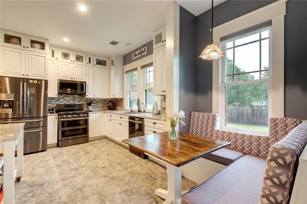 Restored 1922 Craftsman home on large .48 acre lot with plenty of room for a large pool. Gorgeous woodwork throughout this home with meticulous workmanship. 9.5 ft. ceilings, Crown Molding, New windows (2016), High efficiency heat and Lenox A/C (2015), New foundation (2016), New roof (2014). Walnut wood floors in living/dining. 650 square ft. of available space upstairs that can be finished out with a bath, bedroom or large bonus room. Storm shelter under back porch with access from primary bedroom. Pull down shades, Spectrum Internet available. Garage with workshop; 9ft ceilings, 2 Ton lift & hoist on rollers; stainless steel sink, workbench, 2 water faucets and exterior electrical outlet. Plumbed for compressed air. Air hose in main garage. (6) floor volts for an air compressor, safe, etc. , Garden shed with electricity, Work shed with roll up door & electricity. Garage apartment with full bath and fridge above garage with separate entrance and doorbell. 8ft ceilings, 220 Lenox A/C unit. Fridge and Microwave convey. Apartment plumbed for gas stove & water heater.  Wood fence on side yard has 6 inch concrete base around perimeter.