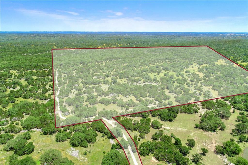 This is a great 50 acre tract in River Mountain Ranch. River Mountain Ranch offers a private Blanco River Park with picnic tables and grills. The photos of the river are the River Park Property is ag exempt for lower property taxes. This tract offers level building sites and beautiful oak trees. Restrictions: Yes, go to River Mountain Ranch's website to view. Tank in aerial is on neighbors property.