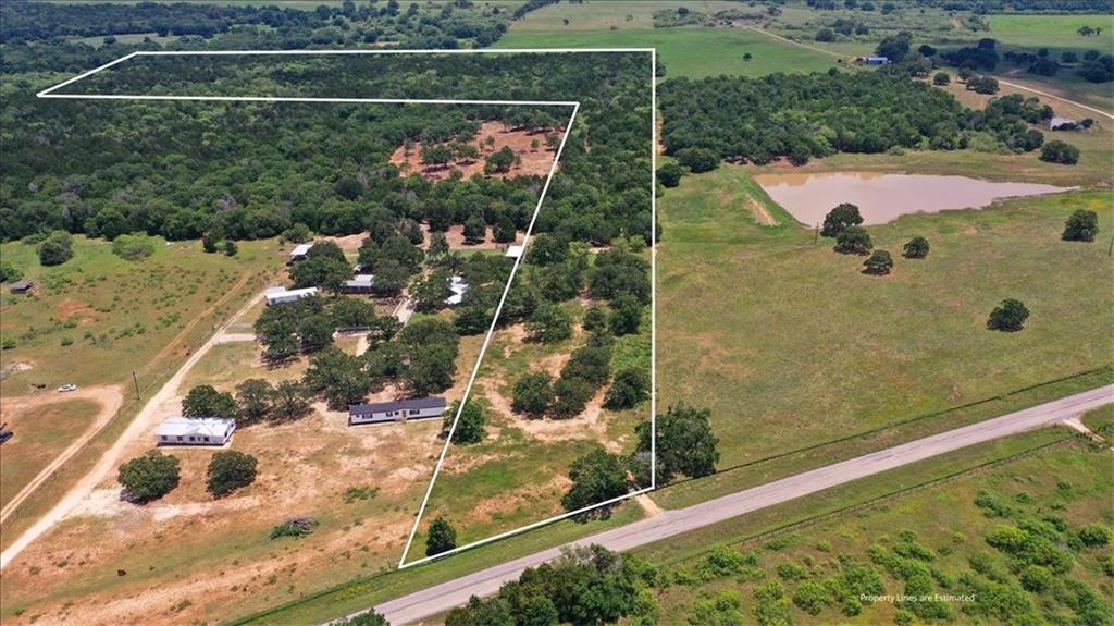 """38 Acres. Electricity and water available. Heavily wooded area. Trees 20 Ft - 40 Ft. 2 minutes from Hwy 290. 10 minutes to Elgin. 15 minutes to Bastrop. 45 minutes to Austin, 45 minutes to Tesla Giga Factory. """"Buyer to verify all info""""."""