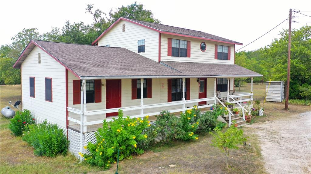 Ready to escape the big city life and move to the country? Tired of HOA's, paying for space to park the RV or boat, and tough restrictions that don't allow you to build on or raise animals? Here's your new home!! Move on out to 4.99 acres (three parcels put together) in the highly acclaimed Liberty Hill ISD. Bonus feature ~ 1 bed/1 full bath attached guest house with kitchen and handicapped accessible features. So many possibilities for this property! Imagine having plenty of room to run and play, mature trees to enjoy, space to add a pool, ample areas to build facilities for horses/cows/show animals, add another home for multi-generational living. Bring your chickens ~ there's already a coop. House is on a well, however City of Georgetown public water is available in neighborhood. 2 HVAC units (2020 and 2017). New well pump Oct 2021. Newly shingled roof last year. Carport/workshop is 12'x16'; RV cover is 15' high/32' long/12' wide; 3-sided shed is 20'x20'. No known restrictions.