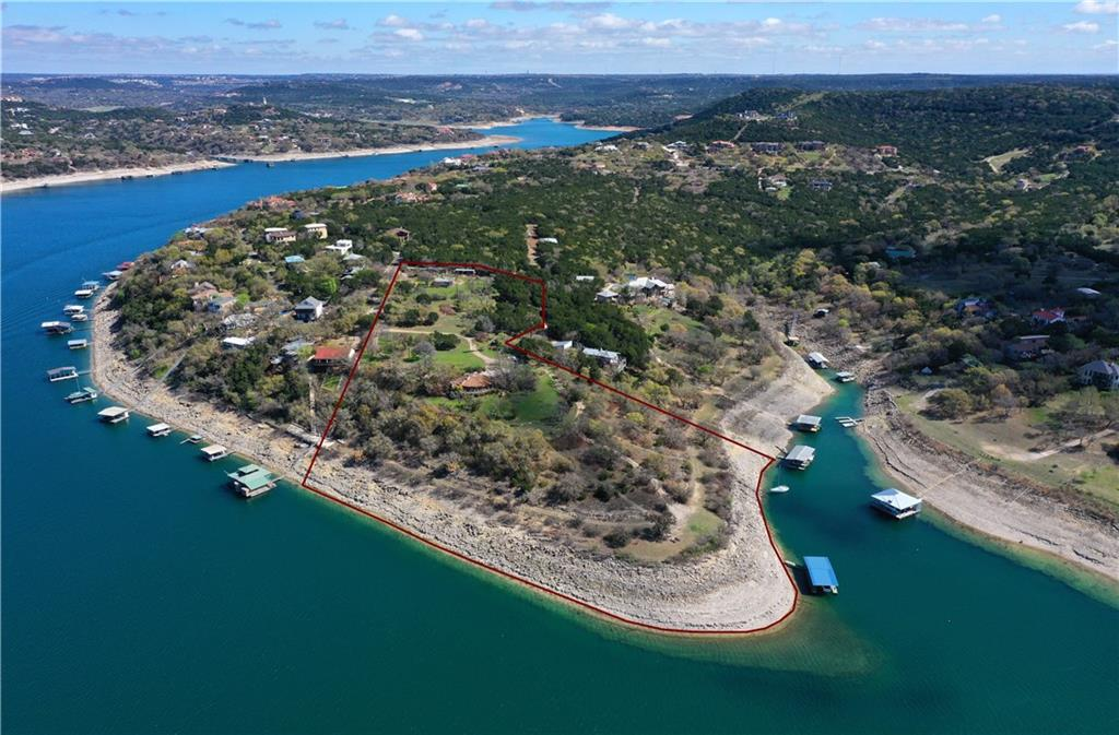 Absolutely spectacular 10 acre deep waterfront peninsula on Lake Travis available with 993 feet of Waterfront footage. Minimal floodplain, incredible views. Level huge building site. Easily walk or drive down to waterfront. Waterfront at mouth of Deep cove as well as main body.  Nice trees with three existing older homes. One home is 3 bed, 2 bath 2,511 sqft per tax records and 1983 build, one home is 2 bed, 1 bath 578 sqft per tax records and 1970 build, one home is 1 bed, 1 bath 250 sqft per tax records and 1983 build. Buyer to verify sqft and homes sold as-is. Minimal value in homes but would make great guest cottages or weekend/vacation homes. Located in Volente feeding to excellent schools.  10 minutes from 620/2222. Major shopping, restaurants, movie theaters etc. 35 minutes to downtown Austin and major hotspots. Lake living at its best. Ready for a dream estate, Family compound or potential Development. Seller will NOT consider a long due diligence. There is not a better waterfront lot on Lake Travis this close in with this access, view and usable acreage. Water source is lake.