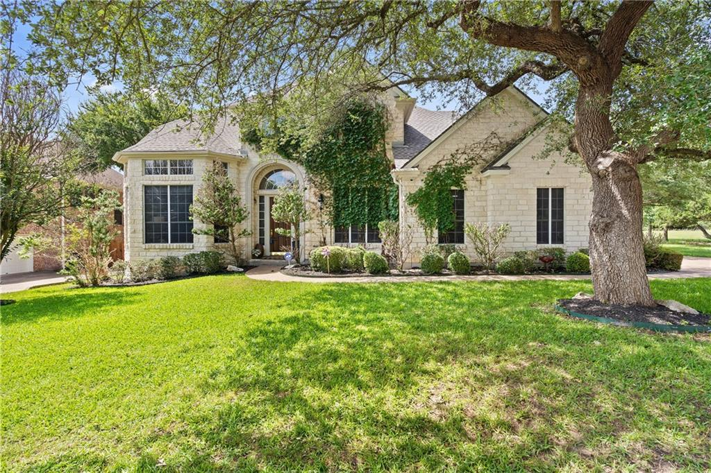 Highly renovated native-Texas-rock 2-story overlooks a 1/8-mile greenbelt for a backyard view that goes on forever. Enjoy abundant wild deer & roadrunners while having coffee in the morning air. Another side just has a permanent grove of oak trees for a rare level of privacy. On the edge of Berry Creek, this one of a kind location offers resort feel with tennis, 25-meter pool, fitness center just steps away. Upon entering, you're greeted in the grand entrance by a crystal chandelier, winding staircase & impeccable finishes. Large bank of windows in the bright living area looks directly into the greenbelt. No stone left unturned during extensive remodeling. From bamboo hardwood floors, gorgeous concrete fireplace, hi efficiency HVAC to quartz countertops, custom tile backsplash, Bosch & Miele stainless steel appliances, and farmhouse sink with filtered water. Recent updates include new roof, all carpet, and Toto bidet with air/heat. The private and serene oasis includes a massive 22x36 lagoon-shaped pool, expansive quartz flagstone decking, waterfalls, slide, covered patio, stainless steel grill, lush lawn & landscaping. Pool was updated with new finish & latest tech- UV disinfection, liquid chlorine injection, autonomous pool robot & an app monitor water quality. Spacious master bedroom features a nook surrounded by a bank of windows, perfect for yoga or Peloton. Remodeled bathroom features glass-encased shower, linen tile, deep-soaking Jacuzzi tub, walk-in closet with shelving. Large office features floor-to-ceiling French doors & built-ins. Storage is prioritized with 2 large storage areas above the garage & second floor. Once upstairs you're greeted by a great room with vaulted ceiling and a 2nd master bedroom with built-ins, fridge, and hidden 10-foot actuated theater screen. Situated in a family-friendly golf & tennis community less than 5 miles from the lake. Welcome home!