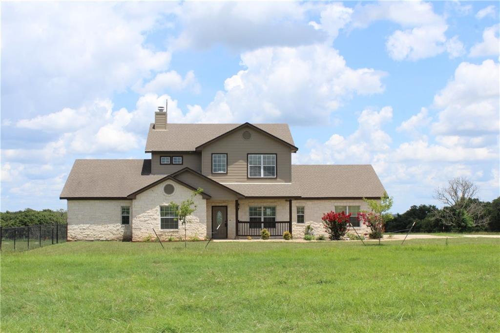 Fantastic opportunity to call this beautiful house, full of Texas Charm on 11+ acres in Thrall, TX, your home!  Enjoy the quiet serenity of the country with easy access to the city.  Located only 45 minutes from Austin, 15 minutes from Taylor, and close to Lake Granger.    This 2 story home has 4 bedrooms and 3 full baths, 2 living, 2 dining, and nice size walk in laundry room with sink.  All countertops in kitchen, bathrooms, and laundry have newly installed granite.  2 bedrooms upstairs with a full bath and game/living room.  Guest accommodations on the first floor with bedroom and full bath.  Master bedroom on first floor with luxurious master bath, double vanities, walk in shower, and large walk in closet.  Stained concrete floors throughout downstairs.  Hand scraped hardwood upstairs.  Concrete patio and wood deck balcony align the back of the house for you to sit, relax, and enjoy the country views.  This unrestricted and Ag Exempt property is set up for cattle, horses, or livestock of your choice, and is currently in hay production.  Good fencing around the perimeter with electric gate entry and new fencing for a backyard by the house.  Walk out onto your private fishing pier and enjoy a nice tank, stocked with fish, that keeps water year round.  Try your hand at growing vegetables in the garden or take on a project in the impressive 60X50 ft. metal barn with partial concrete slab and electricity.  Could be used as a workshop, tractor, boat, hay storage, or can accommodate FFA/4H animals.  The opportunities are endless!  This is a MUST SEE!