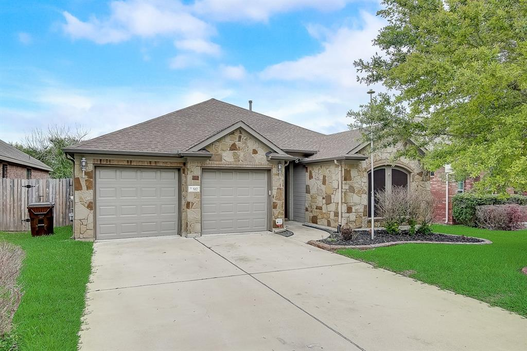 This Hutto one-story home offers granite countertops, and a three-car garage.