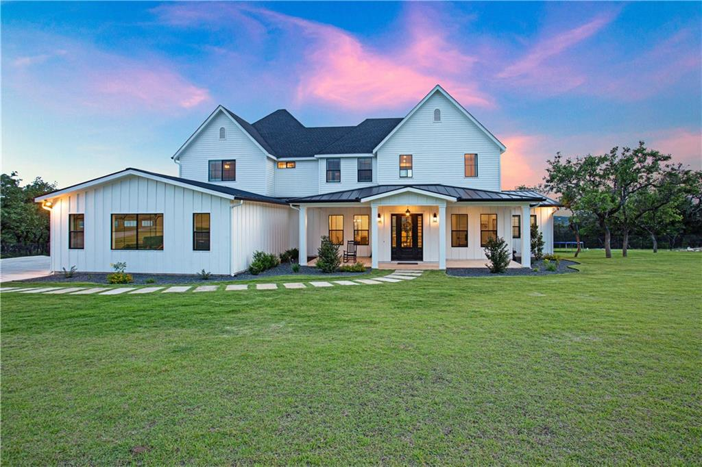 Gorgeous hill country farmhouse built by Alkire Construction, voted Dripping Springs best builder in 2020. Interior of home includes 6 bedrooms, 2 on main level, 4.5 bathrooms, open floor plan, private office, butler pantry, high-end appliances and finishes. Outside features panoramic hill country views, covered front porch and back porch, built in outdoor grill, stunning pool with waterfall feature, landscaping, and wet weather creek at the back of the property. Property is ag exempt and in Dripping Springs ISD.