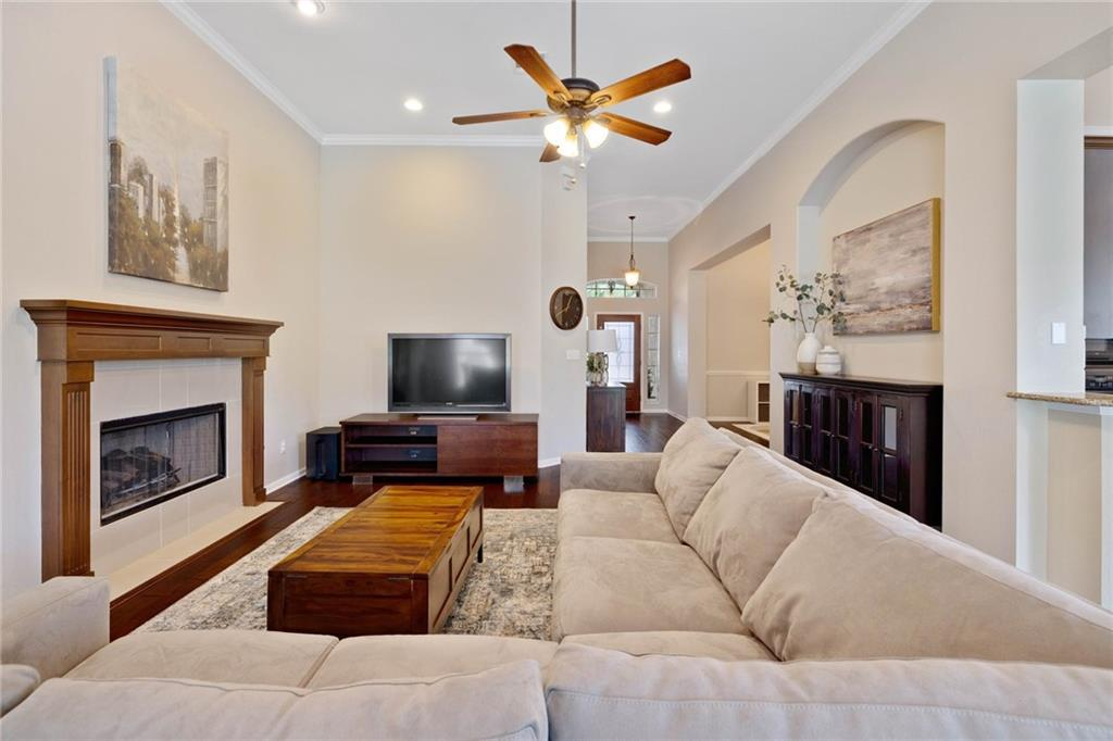 Welcome to this alluring 1-story cul-de-sac home built on one of the largest lots in the prestigious Ranch At Brushy Creek with a new roof and gutters as of June 2021! This open concept home features a striking living room with high ceilings, a fireplace to spend a cozy night with family, and beautifully hand-scraped hickory hardwood flooring. The floorplan is a 3-bedroom + a dedicated office perfect for those who work from home or even convert it to another bedroom or playroom with nearby access to a powder room. With an oversized kitchen, there is an abundance of storage along with a butler's pantry that leads to the formal dining room, a large eat-in breakfast room overlooks the lush backyard. Storage is abundant throughout the home highlighting a coat closet and linen closet and has an attic with decking for more storage options! Enjoy outdoor fun in the large private backyard featuring a covered patio and mature trees with tons of live oaks surrounding the home on an extra-large lot! Near highly ranked schools: Ronald Reagan Elementary, Florence W Stiles Middle, and Vista Ridge High School! Easy access to great community amenities: Junior size Olympic pool, kids playground, hike and bike trails, splash pad and toddler pool, covered pavilion and picnic areas!
