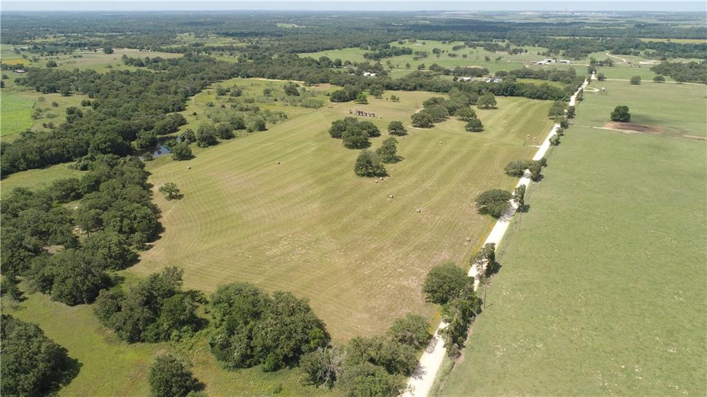 Enjoy the privilege of privacy on 33 pristine acres. This tract of land is simply breathtaking & provides a natural getaway and only 45 minutes to Round Rock and 25 minutes to Taylor.  Come relax in the country and enjoy the peace and quiet with nature's beauty surrounding you. There are 2 nice ponds and the perimeter is fenced.  Electricity at the barn. There is a cute portable building you have to check out that you could Airbnb. Come build your dream home or park your RV and go fishing with grandkids. This won't last long! The land you have been looking for is here! Professional drone photos coming next week.