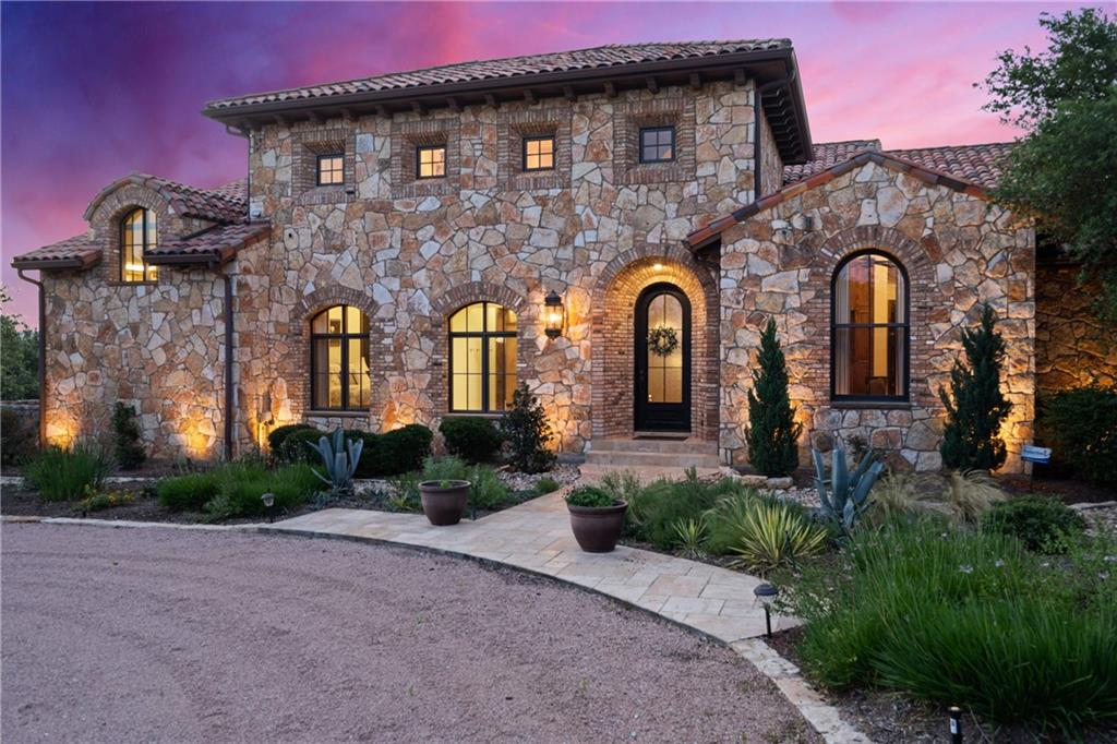 One of the best executed homes on the market, with gated entry and a winding drive that leads to a beautiful Italian villa. Enter into a 19' entry with groin ceiling that leads to an open living area, with reclaimed oak beams, that overlooks a sparkling, negative-edge pool and pond. Stone steps lead you down below to amazing rock formations, lit at night, where you find a cascading waterfall and refreshing pond for dipping your toes in and cooling off. Sit at the bistro table and stools next to the waterfall and sip cocktails or have lunch. From there, you can walk down to the copper gazebo or beyond that to the boat dock with lift. This is resort style living. Geothermal HVAC, 39,000-gallon rainwater harvesting for the home, and two wells with two 2400-gallon storage tanks for irrigation, 28x50 solar pole building with 90 250w solar panels that feed into PEC. 50 amp electrical is available in the garage and under the solar building for an RV.