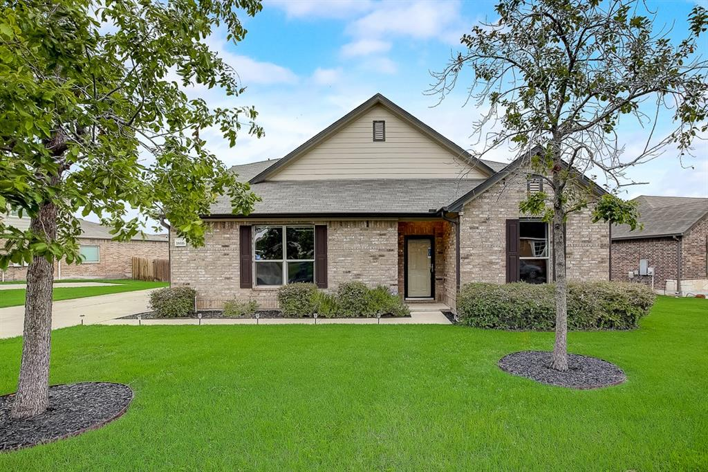 Built in 2013, this Pflugerville two-story cul-de-sac home offers granite countertops, and a two-car garage.