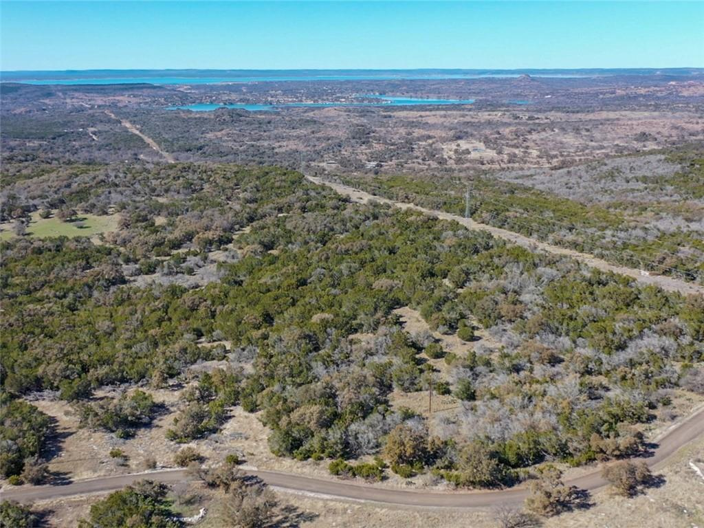 Gorgeous 20+ acre tract in the gated, coveted Castleview Ranch in Burnet County, Texas! Beautiful views of the Texas Hill Country will delight, while the sunsets will impress! Faulkenstein Castle nearby with rolling hill country views. Build up for even better views! Mature oaks cover this large tract. Meandering roadway adds to the intrigue. Private acreage tracts like this are hard to come by. Check out this beauty today! Additional land available. Wildlife exemption in place.