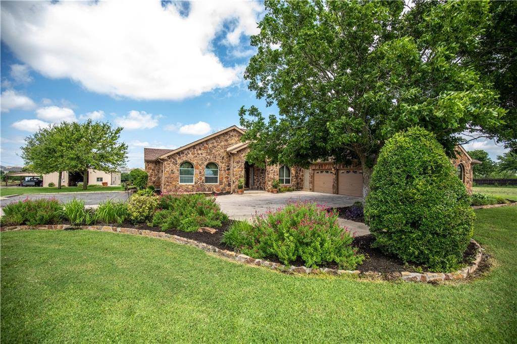 Close to Pflugerville, Hutto, Round Rock & Austin. Easy access to the 130 Toll. Ag-exempt, stocked fishing pond, finished-out metal building with bathroom, kitchen & workshop, garden, chicken coop. Plenty of room for an RV. NO HOA.  4/3 stone home with 3 car garage and sunset views from the back porch. Property is set up for entertaining and could also be home to a business or offices. The location makes this a prime investment. Buyer to verify all information is correct.