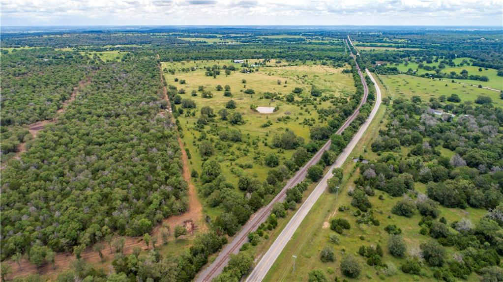 22.6 undeveloped ag-exempt acres- the possibilities are endless! Additional adjacent tracts available. Located minutes outside of Smithville, this scenic property must be seen in person to be truly appreciated. Property slopes down from front to back, and includes several great building sites. Abundant oak trees and strands of live oaks. Escape the city, enjoy the beauty of nature and Texas night skies!