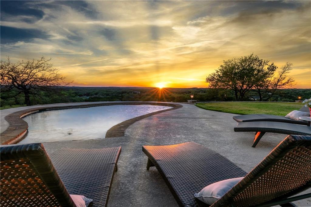 This stunning luxury recreational and equestrian ranch is located just 18 miles from Austin city limits. Almost 35 manicured and park-like acres, featuring groves of century live oaks and 360 panoramic views to be enjoyed while being a quick 5 mile drive to Leander retail. The custom luxury ranch home features breathtaking views from all of the windows, 5 bedrooms, 3 full bathrooms, spacious entertainer's living room that is open to the kitchen and dining space. Sunsets are spectacular overlooking the pool and pastures on you outdoor patio. Equestrians will enjoy the thoughtful amenities, including 145' x 175' professional grade arena, 60' round pen, and miles of gently rolling trails around the property. The commercial quality horse barn features four 12' x 12' stalls with 18' runs, wash bay with hot water, lofted storage area/workshop with sink and electric, lofted hay room, and tack room. Other features of the property include 3500 gal rainwater cistern at the barn, 50' x 20' equipment barn with 12' awning and 20' horse trailer covered parking. Over 2 miles of drill-pipe and King Ranch fencing and cross fencing. Ag exemption in place for property tax savings. This Texas treasure is located in a deed restricted enclave and it is not eligible for subdivision or commercial use. Enjoy country living, close to the city, as a perfect weekend getaway, family compound, or full time retreat.