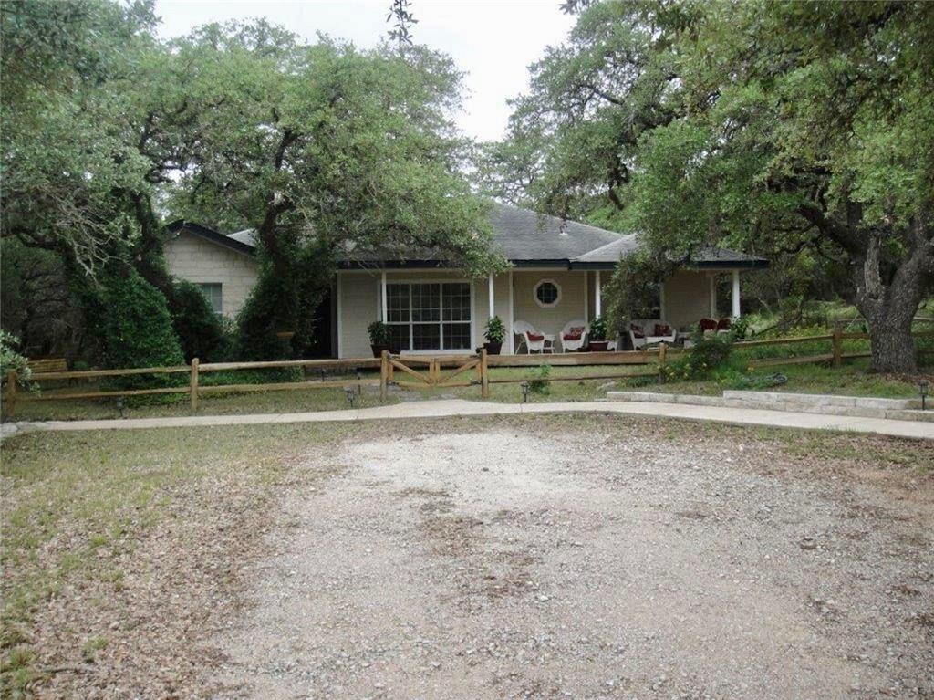 Nice home on 24.655 acres of beautiful rolling terrain and an oversized garage.  The tract extends to Hwy 290 via Three Sisters Lane, a 60' private road easement providing access to tracts 3 and 4. The land is beautiful with scattered oaks and friendly topography. There are numerous home sites and prime building opportunities as well as development or commercial if included in the entire tract of up to 61 acres.