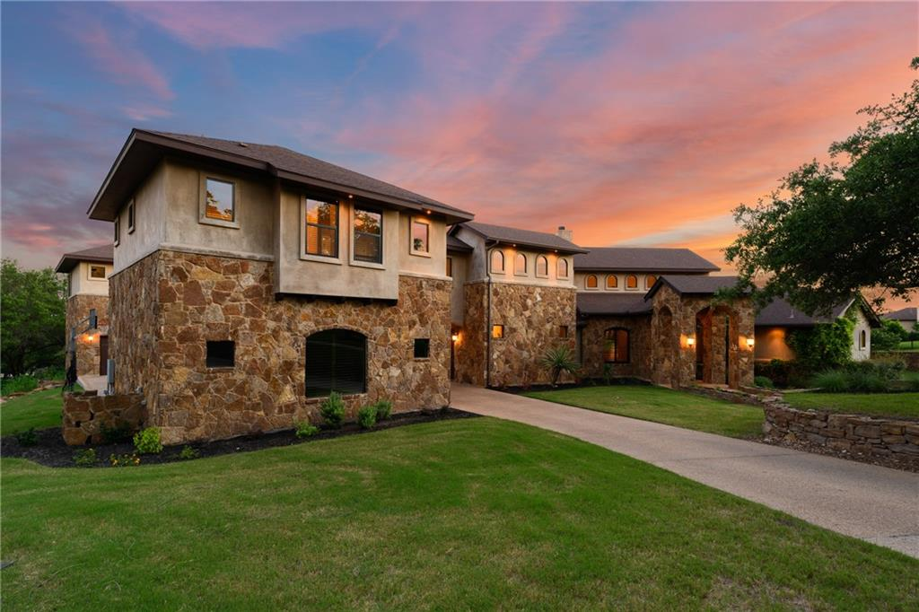 """The Gem of Crystal Falls Grand Mesa! Hill country living at its finest in sought-after Grand Mesa, Crystal Falls' premiere gated community.  From the rare panoramic view lot with mature trees to the fine finishes throughout, no expense has been spared in outfitting this one-of-a-kind property. The main house includes 5,897 sqft, 6 bedrooms, 4 full bathrooms, and 2 half bathrooms, media room, and game room with wet bar and exterior door to pool/ backyard. The 650 sqft detached casita has 1 bed/1 full bath along with a living room. Multi-generational living at its best! Fit for your favorite in-home culinary aficionado, the gourmet kitchen comes complete with granite countertops, Thermador stainless steel appliances (including sub-zero refrigerator), loads of storage, massive center island, walk-in pantry and laundry room. Huge beamed ceilings and large windows in the living room bring the outside in with an abundance of natural light and hill country views. A true master-suite with dual walk-in closets, luxurious soaking tub, grand walk-in shower, and dual vanities offers a spa-like experience.  The downstairs secondary bedrooms have character–one with a loft and another with a (removable) play house façade connected with a Jack-and-Jill bathroom. There is a dedicated office with walk-in closet and full bathroom that can also serve as a bedroom. Upstairs are 2 additional spacious secondary bedrooms and a Jack-and-Jill bathroom. Entertainer's dream with the downstairs game room featuring custom-made barn doors, a wet bar with storage and seating and a media room. Resort-style secluded backyard includes custom, built-in, heated pool and spa with grotto and waterfall, putting green, and tons of outdoor living space, including a built-in outdoor kitchen with gas grill and """"Big Green Egg."""" 4 car garage with additional circular driveway gives plenty of room for parking and guests. This incredible residence is the personal home of the proprietor of Klaer Custom Builders."""