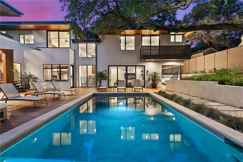 With its impeccable finishes, discerning layout, and modern amenities, this contemporary masterpiece in Travis Heights is a true compound estate that was designed to maximize and connect the inside and outside as closely as possible for sophisticated living and dramatic entertaining.  Designed by Jeff Krolicki of Makers Architecture and built by Steve Johnson of Upper Construction, this house sits on a sizable double lot and offers exquisite materials throughout the home.  The luxurious great room features museum-finish walls, tall ceilings, white oak floors, a fireplace and expansive steel windows and doors. A state-of-the-art kitchen is conveniently located between the breakfast and dining rooms with a dedicated space for the true wine or cigar connoisseur.  The lavish primary suite awaits with its own wing boasting a fire place, luxurious bath, private covered deck and gracious walk-in California closet.   Two additional guest bedrooms with en-suite baths are situated on secondary level. One office or optional bedroom and one exercise/optional bedroom, both with en-suite baths and separate entrances, are ideal for the work from home professional or work out aficionada. Many other features include a three-car garage and an outdoor living and kitchen area with a pool and spa.  This Travis Heights stunner is as much a work of art as it is a comfortable contemporary home.  Lush landscaping and unparalleled privacy in the heart of Central Austin. Just a few quick blocks to Ladybird Lake hike and bike trail and minutes from SOCO's shopping district and restaurants.