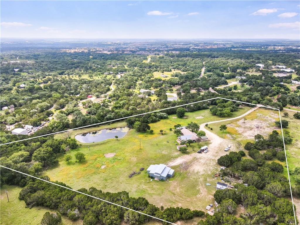 10.63 beautiful acres in growing Leander, Texas. Single story house with amazing outdoor living space. Entertainers dream with a full-size bar accented with reclaimed wood, a stone fireplace, and an incredible view of the Texas scenery & private pond. Large Barn on the property was a horse stable but is now used for storage.