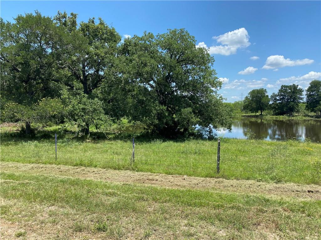 Beautiful acreage with lots of beautiful, large Oak trees, seller says abundant wildlife.  Approximately 950 Feet of road frontage according to tax records,  This land is perfect to build your dreamhome, manufactured homes okay, recreation or hunting.  Owner says no deed restrictions. 2 large ponds do have fish.  owner says it has abundant wildlife.  NO HOA! Public water and electricity available at the road.  Conveniently located approx 2 miles from FM 812 for easy commute.  Tesla plant will be about 20 miles away.