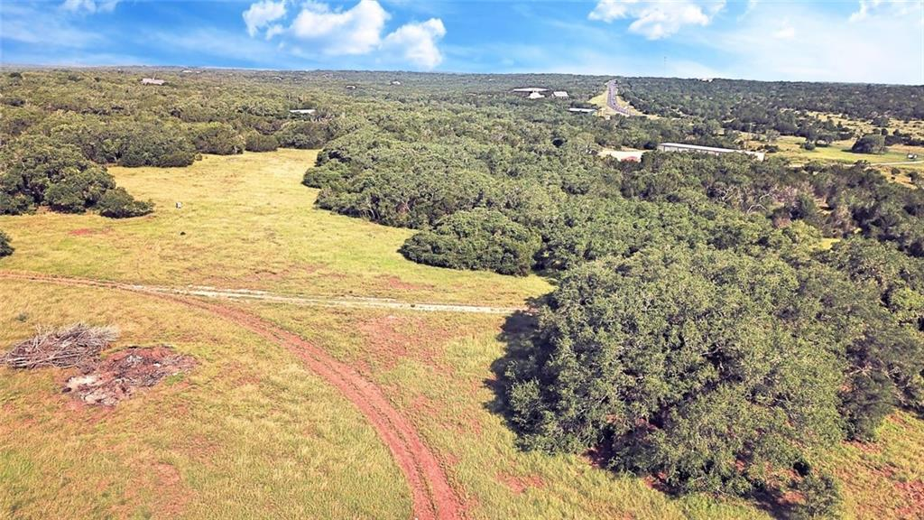 Unbelievable ranch property with access to I35 and Wimberly within mins. Both Austin and San Antonio are 30 mins away.  Rolling Hills, lush pasture land, waterholes, caves  and an abundance of wild life from Cottontail deer, boars, wild turkeys, doves  to name a few. Multiple generational Oak Groves with Towering Oak Trees, Vista territorial and hill country  views .A  natural Canyon runs along property line of Lot 1&2. Numerous homes sites to choose from, property already has AG Exemption.