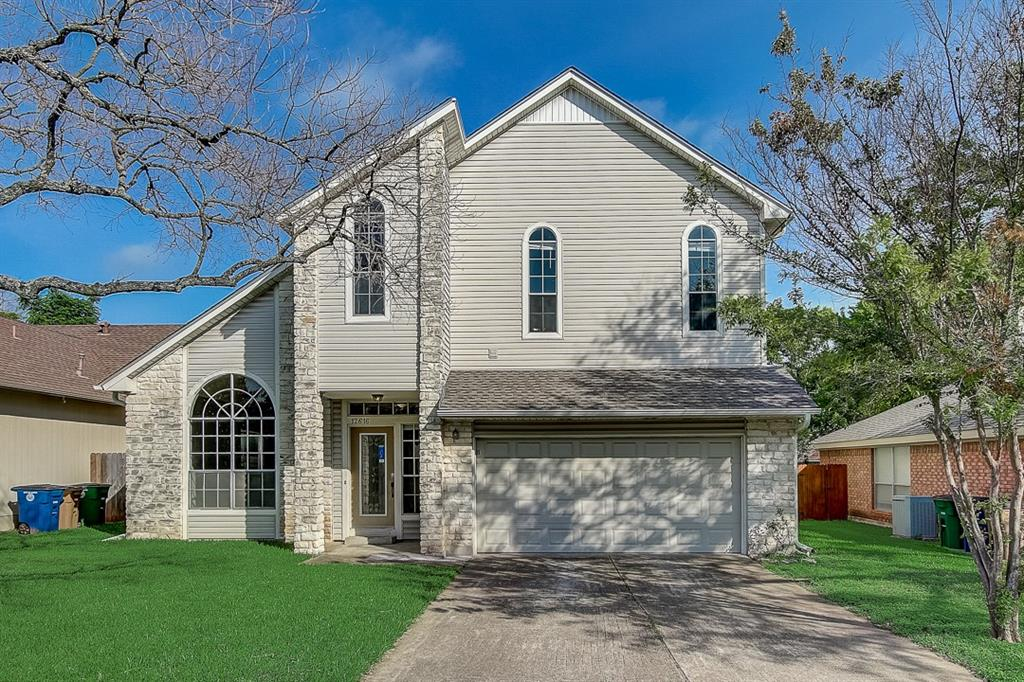 This Austin two-story cul-de-sac home offers a patio, and a two-car garage.