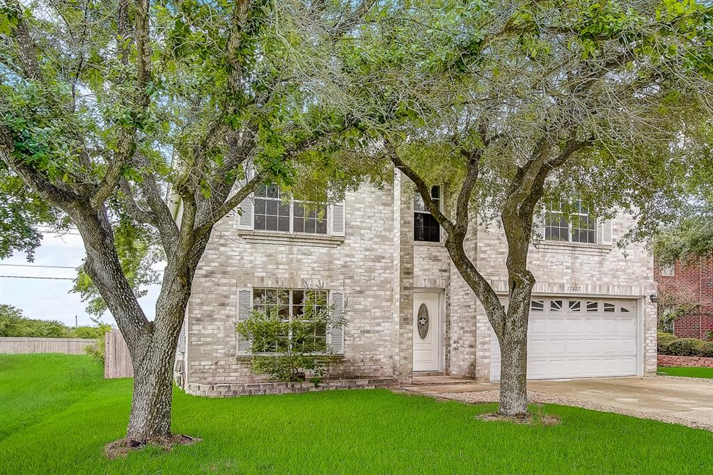 This Pflugerville two-story cul-de-sac home offers a two-car garage.
