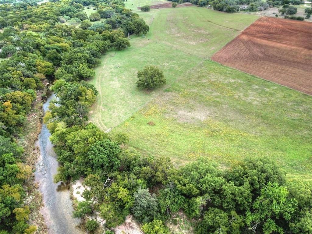 With over 1,700' of Sulphur Creek frontage, located in Lampasas County near the city of Kempner, this piece of property is perfect for a permanent home or weekend getaway.  The river bottom along the creek is covered by majestic pecan, oak, elm and burr oak trees. The bottom field at approximately 13 ac has been primarily used to grow coastal hay but can include wildlife food plots that will attract white-tail deer and other native wildlife to the low fence property.  The middle of the property has several home sites with hundreds of live oak trees.  The front of the property is another cleared area that has been previously used for cultivation.  There is a well located on the property and electricity is located on the main road of the property. Features: dove, deer, fishing, rivers, wildlife. This property is Ag exempt. No Restrictions.